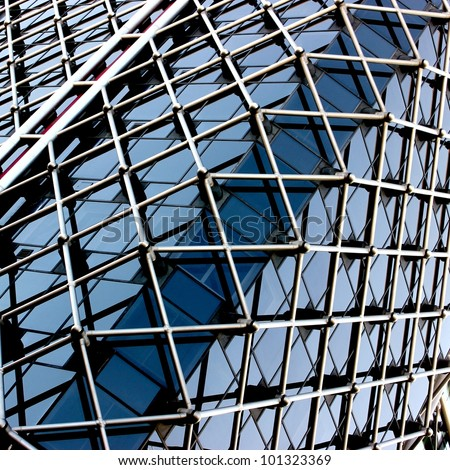 Complex building structural detail, blue metal bars and glass - stock photo