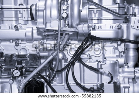 Complex car engine with lots of details - stock photo