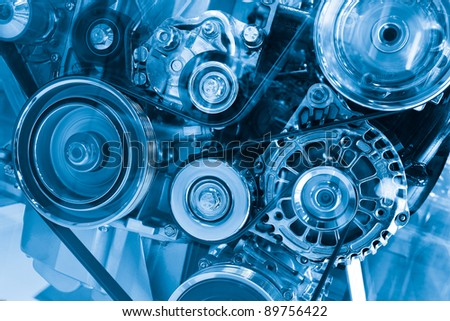 Complex engine of modern car with lots of details - stock photo
