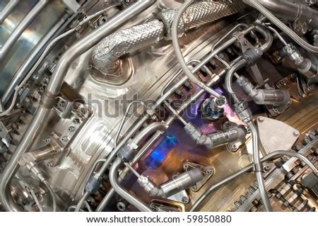 complex hydraulic engineering inside an aviation jet engine - stock photo