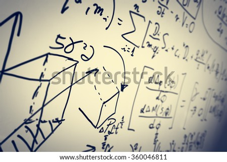 Complex math formulas on whiteboard. Mathematics and science with economics concept. Real equations, symbols handwritten by a professional.  - stock photo