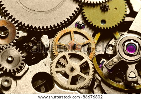 COMPLEX MECHANISM INSIDE OF A WRISTWATCH 3:1 LIFE SIZE MACRO   - stock photo