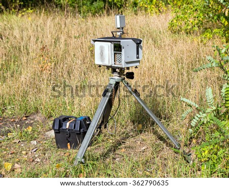 Complex mobile speed camera, mounted on a tripod - stock photo