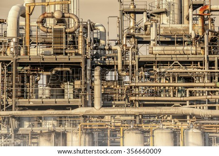 complex network of pipes in a factory - stock photo