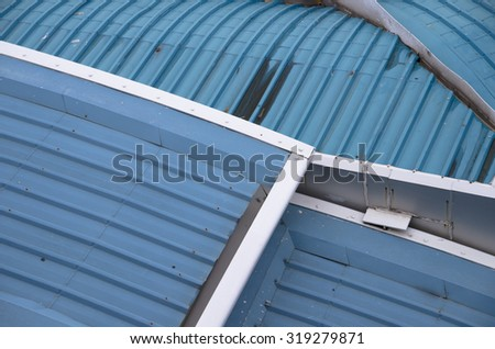 complex of roof structure. Corrugated metal texture surface