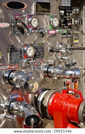 Complex pumping and valve controls on a pumper firetruck. - stock photo