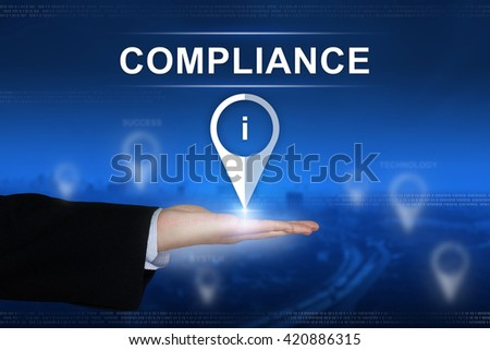 compliance button with business hand on blurred background - stock photo
