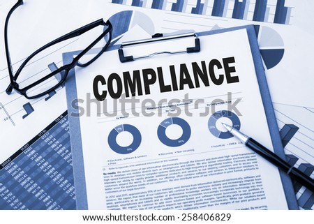 compliance concept with financial graph and chart - stock photo