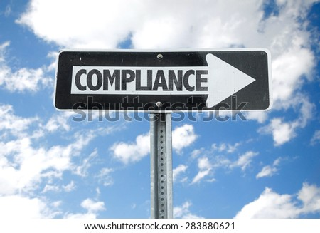 Compliance direction sign with sky background - stock photo