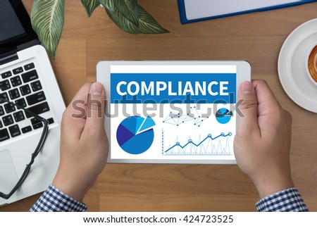 COMPLIANCE man hand Tablet and coffee cup - stock photo