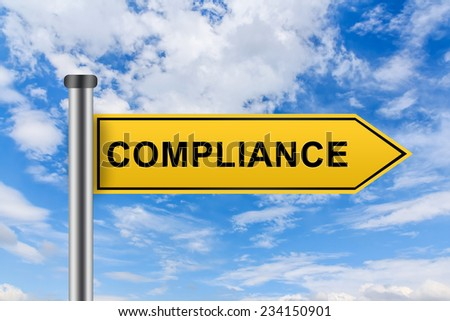 compliance words on yellow road sign on blue sky - stock photo