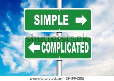 Complicated and Simple signpost with a blue sky in a background - stock photo