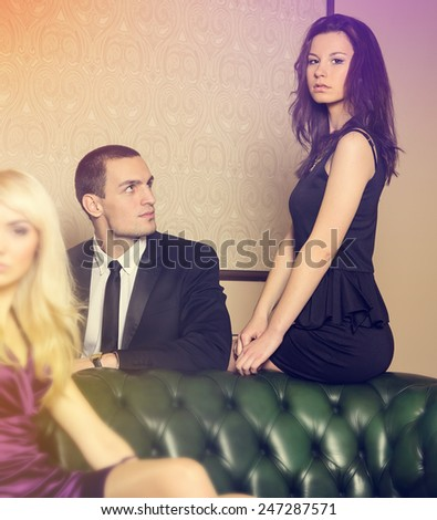 http://thumb7.shutterstock.com/display_pic_with_logo/1286701/247287571/stock-photo-complicated-love-relationship-between-three-people-at-party-at-the-club-one-man-and-two-women-247287571.jpg