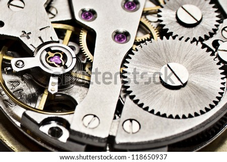 complicated mechanism old clock closeup