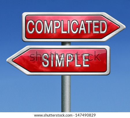 complicated or simple the easy or the hard way roadsign arrow on blue background crossroads  - stock photo