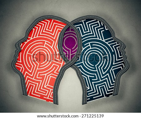 Complicated relationship as concept for group therapy or marriage counseling as two human heads made from maze merging together as icon of partnership solutions isolated gray background  - stock photo