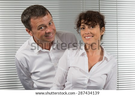 Complicity between business people , man and woman at office - stock photo