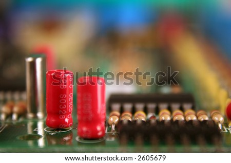 Component close up, electrolytic capacitor - stock photo