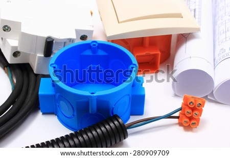 Components for use in electrical installations and rolls of electrical diagrams, accessories for engineering work, energy concept - stock photo