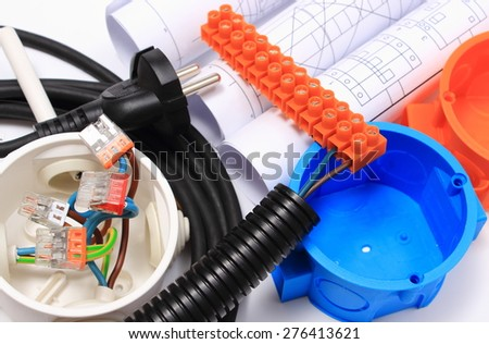 Components for use in electrical installations and rolls of electrical diagrams, copper wire connections in electrical box, energy concept - stock photo