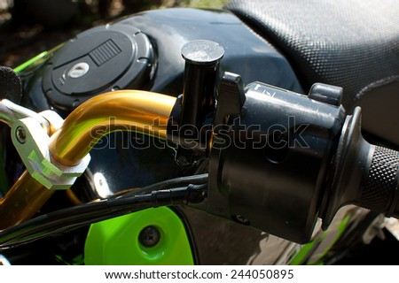 Components of the motorcycle Close racing in the field - stock photo