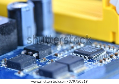 Components on board. PCB to PC. Chip, capacitor and connectors on the motherboard of a personal computer. Modern technological background.
