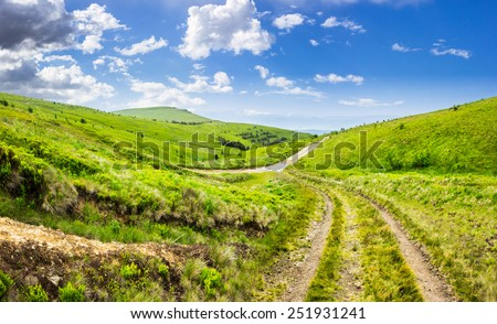 composite highland landscape. with pine forest far away near the road through hillside meadow - stock photo