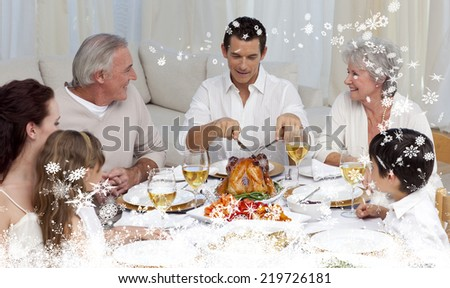 Composite image of a Father serving turkey to his family in a dinner against snow - stock photo
