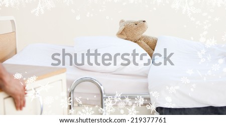 Composite image of a Frost against teddy bear alone in a hospital bed - stock photo