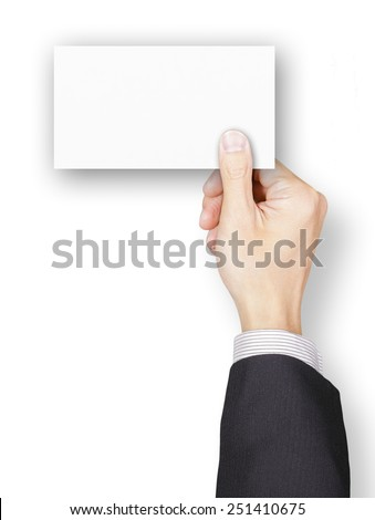 Composite image of a hand of businessman holding a blank name card - stock photo