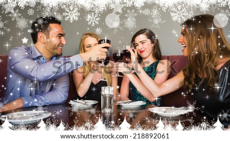 Composite image of a Happy friends drinking red wine in a bar against twinkling stars - stock photo