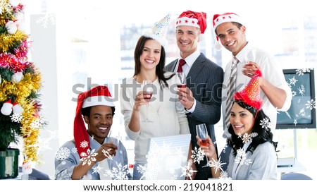 Composite image of a Smiling business team drinking champagne to celebrate christmas against frost - stock photo