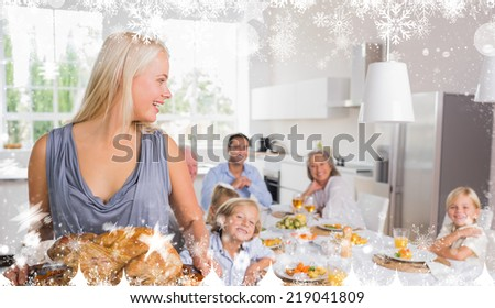 Composite image of a Woman looking her family against snow - stock photo