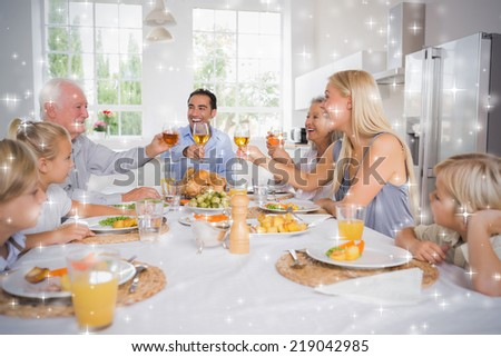 Composite image of Adults raising their glasses at thanksgiving dinner against snow - stock photo