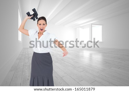 Composite image of angry businesswoman throwing binoculars away while posing