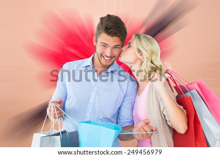 Composite image of attractive young couple holding shopping bags - stock photo