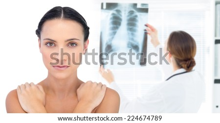 Composite image of beautiful model posing looking at camera - stock photo