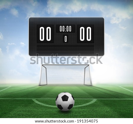 Composite image of black and white football and scoreboard against football pitch and goal under blue sky - stock photo