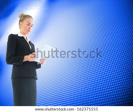 Composite image of blonde businesswoman holding new tablet - stock photo