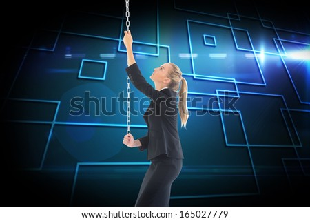Composite image of blonde businesswoman pulling a chain