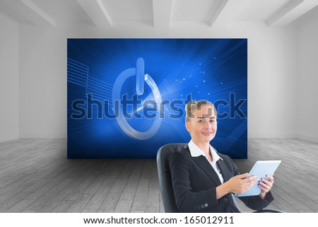 Composite image of blonde businesswoman sitting on swivel chair with tablet