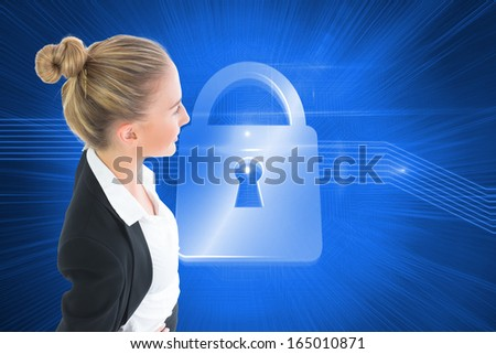 Composite image of blonde businesswoman standing with hands on hips