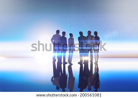 Composite image of business colleagues standing against blue and white sky
