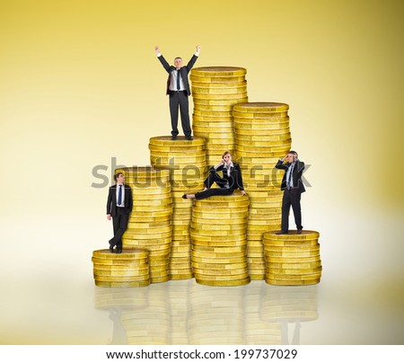 Composite image of business people on pile of coins against yellow vignette - stock photo