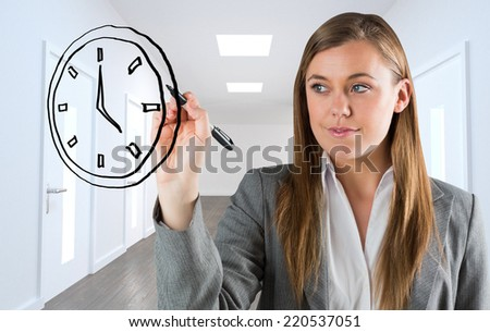 Composite image of business person drawing a black clock - stock photo