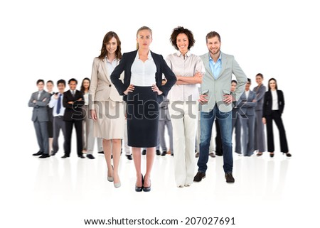 Composite image of business team looking at camera on white background