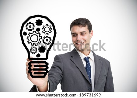 Composite image of businessman drawing light bulb against white background with vignette - stock photo