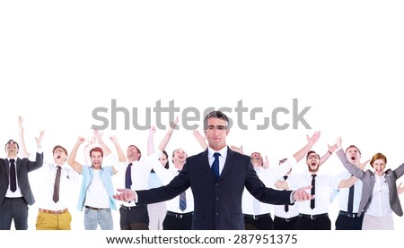 Composite image of businessman in suit spreading his arms outwards - stock photo