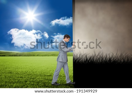 Composite image of businessman pushing away scene of dark gothic scene with trees