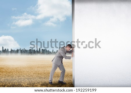 Composite image of businessman pushing away scene to large city on the horizon